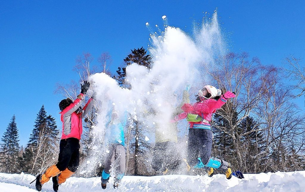People play happily in the icy world.